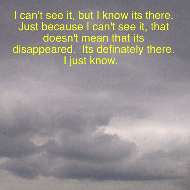 Photo of London sky with grey clouds with a quote
